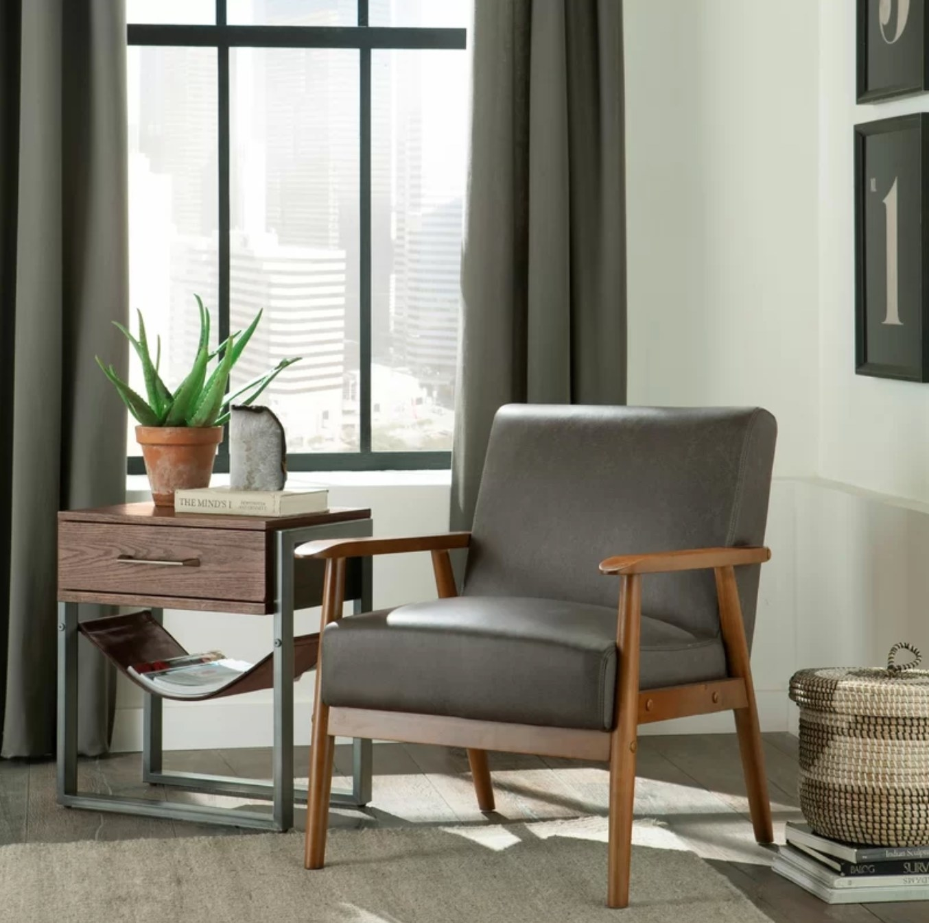 The faux leather armchair in steel with a wood frame