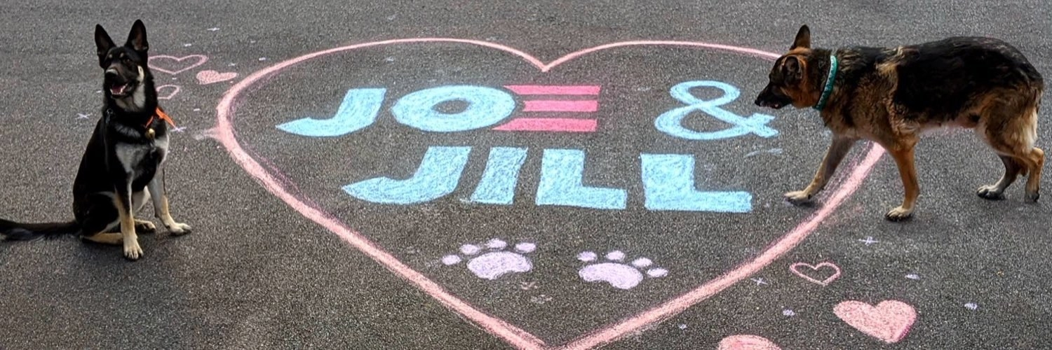 "Champ and Major next to a chalk drawing of a heart that says ""Joe and Jill"" inside of it"