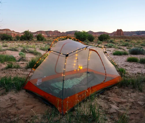 clear tent with lights strung around it