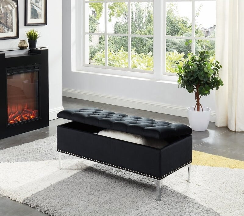 The black bench with metal studs on the bottom