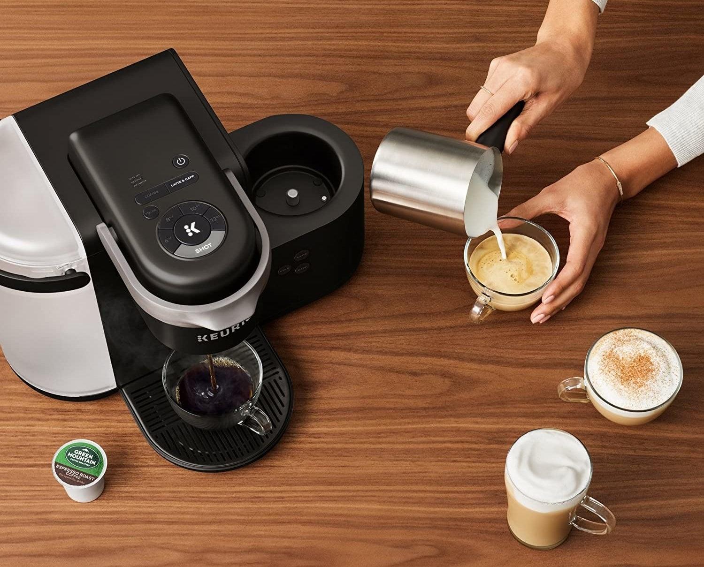 The black Keurig coffee maker pouring an espresso shot