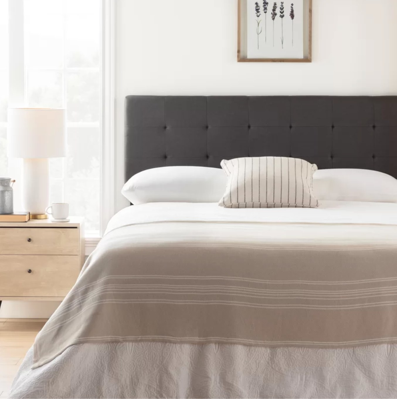 The upholstered headboard in gray