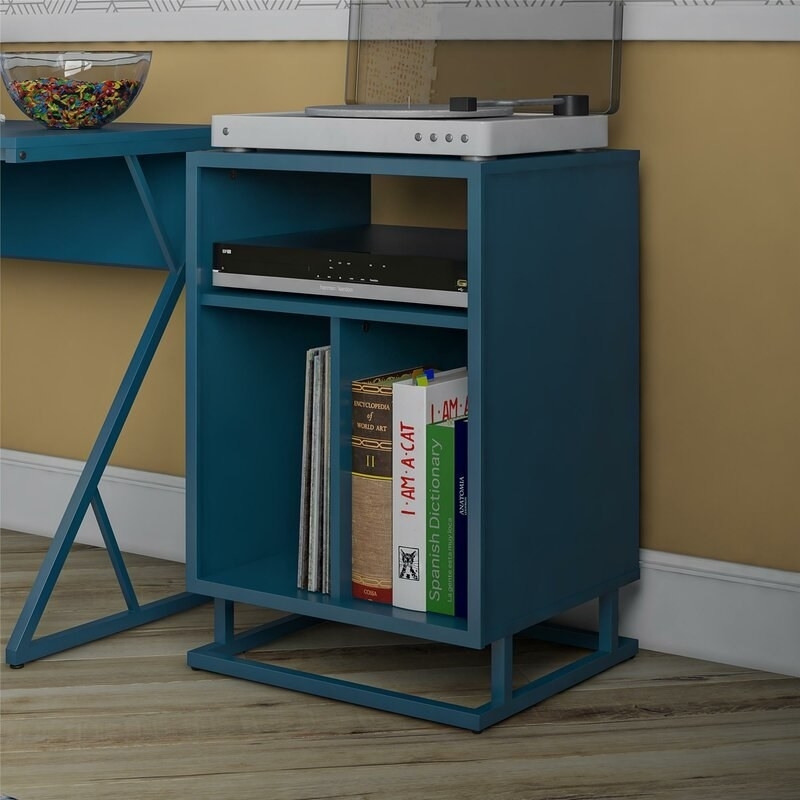A pale blue end table with open storage