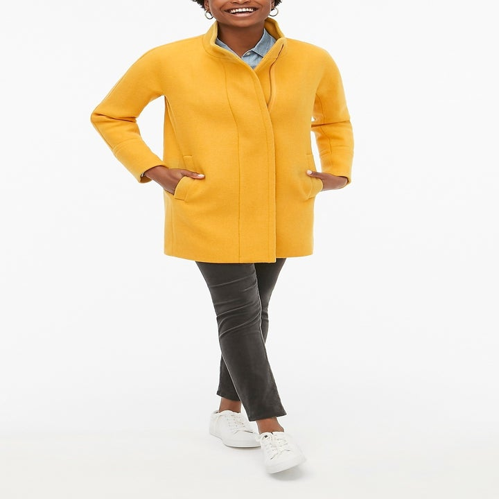 model wearing yellow jacket