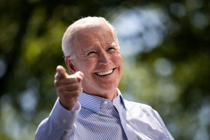 Joe Biden pointing with a huge smile on his face