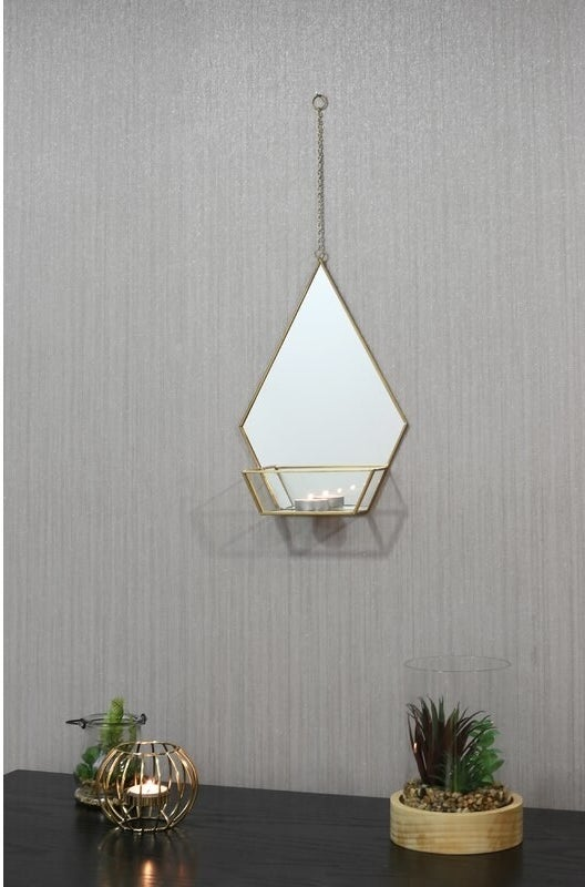 The accent mirror with shelf and a lit tealight on it