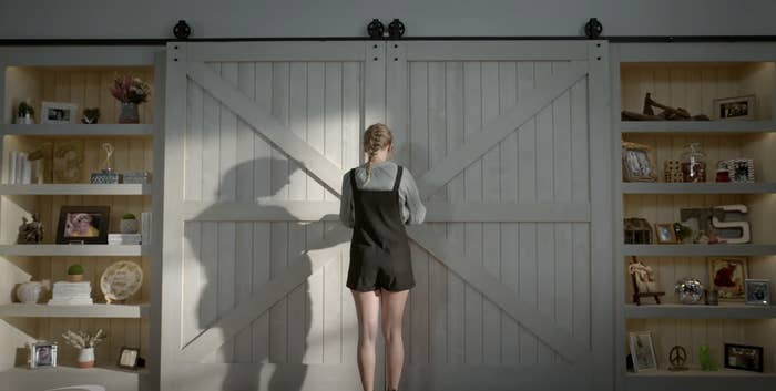 Taylor standing in front of the doors to her large closet
