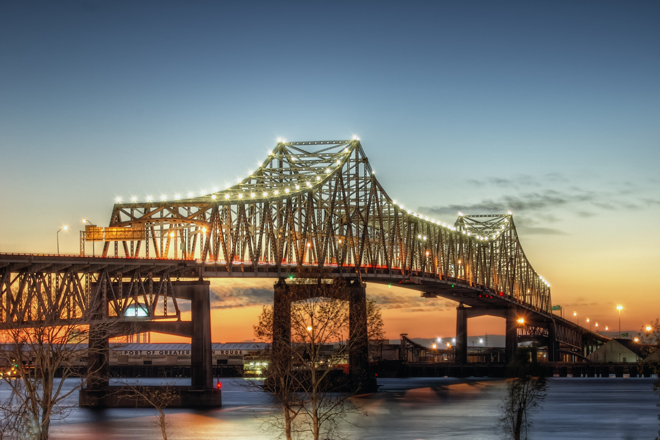 Mississippi River Bridge in Baton Rouge lit up during sunset