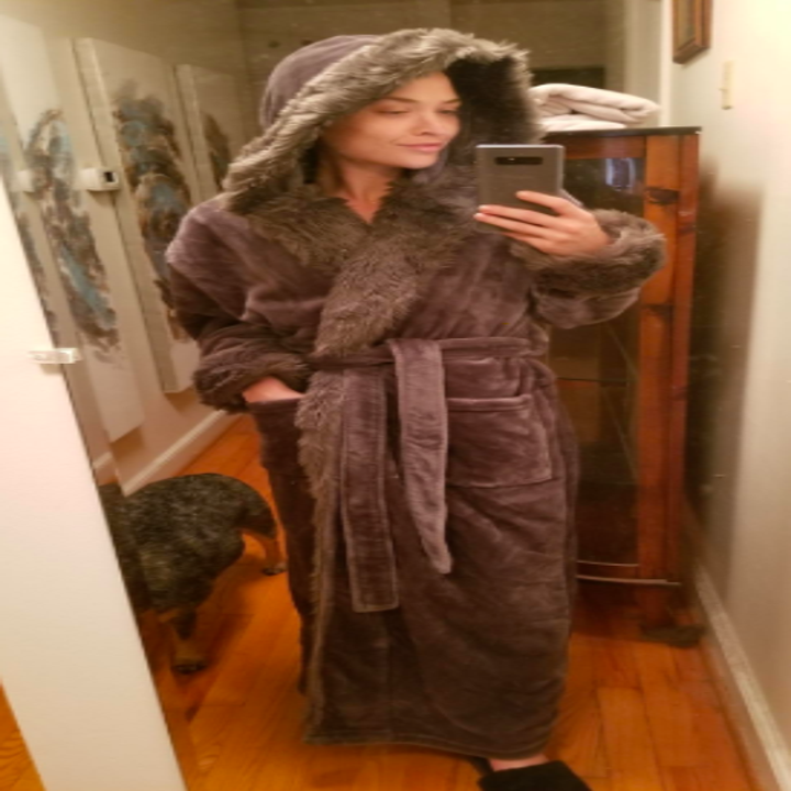 a reviewer wearing the robe in brown