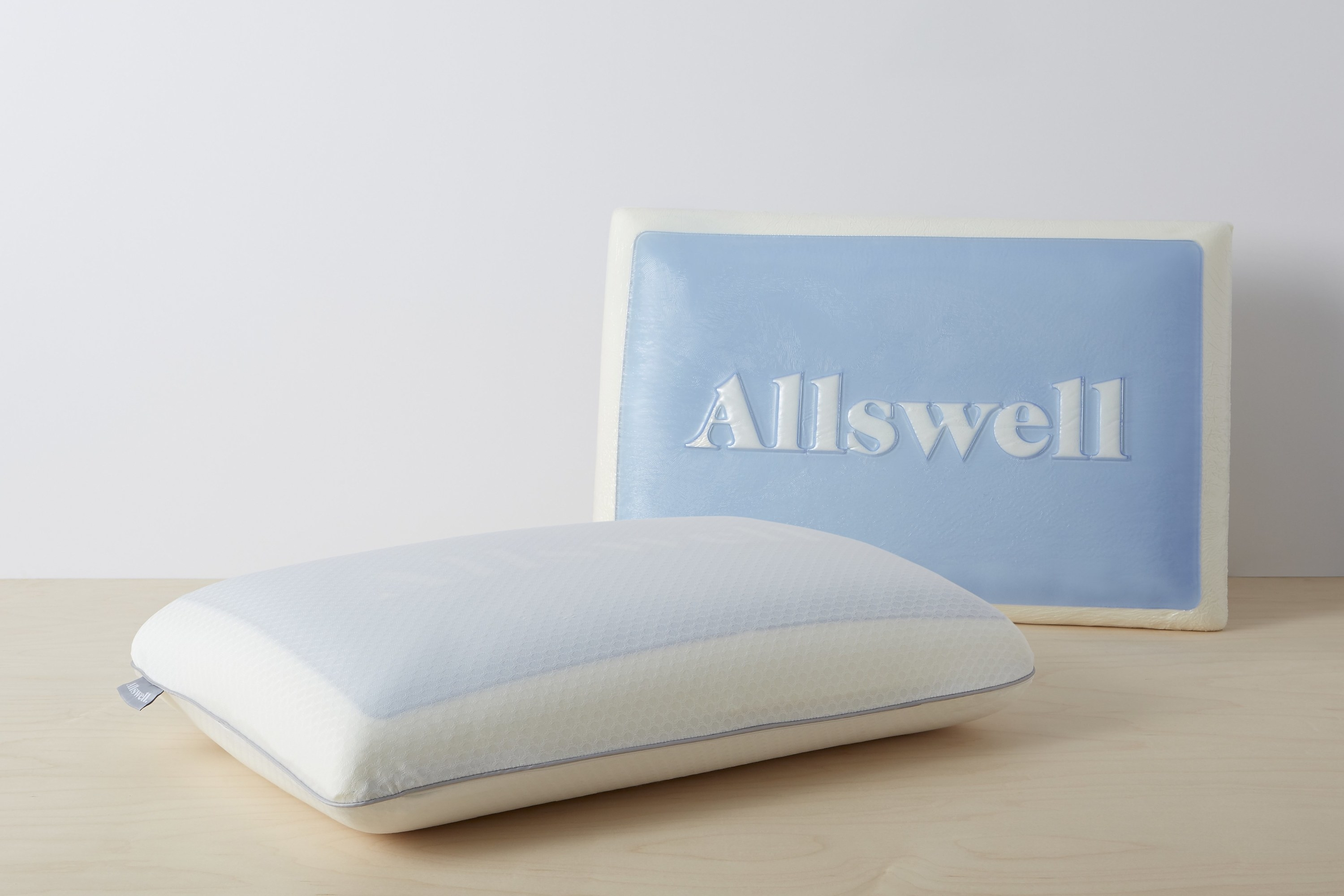 The memory foam pillow next to its pillow cover