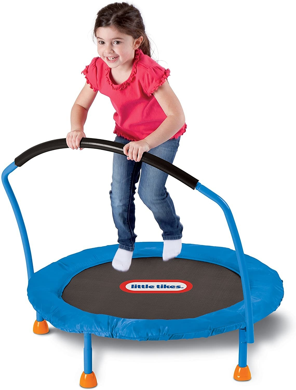 A young child bounces on a trampoline.