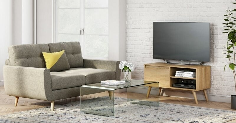 A clear plastic coffee table in the center of a living room