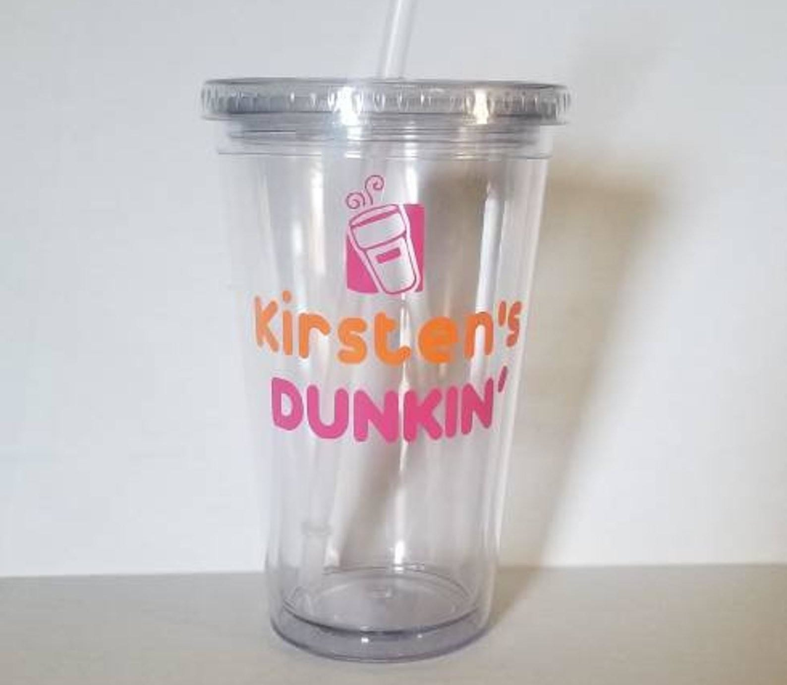 A reusable cup that says Kirsten's Dunkin