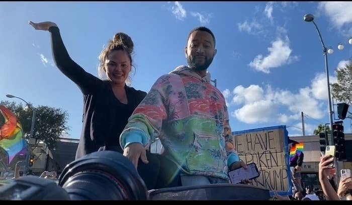 John Legend and Chrissy Teigen celebrate the election results as they dance while riding around in West Hollywood with friends.