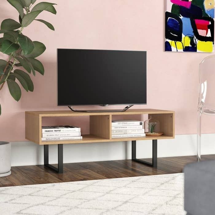 The brown TV stand in use