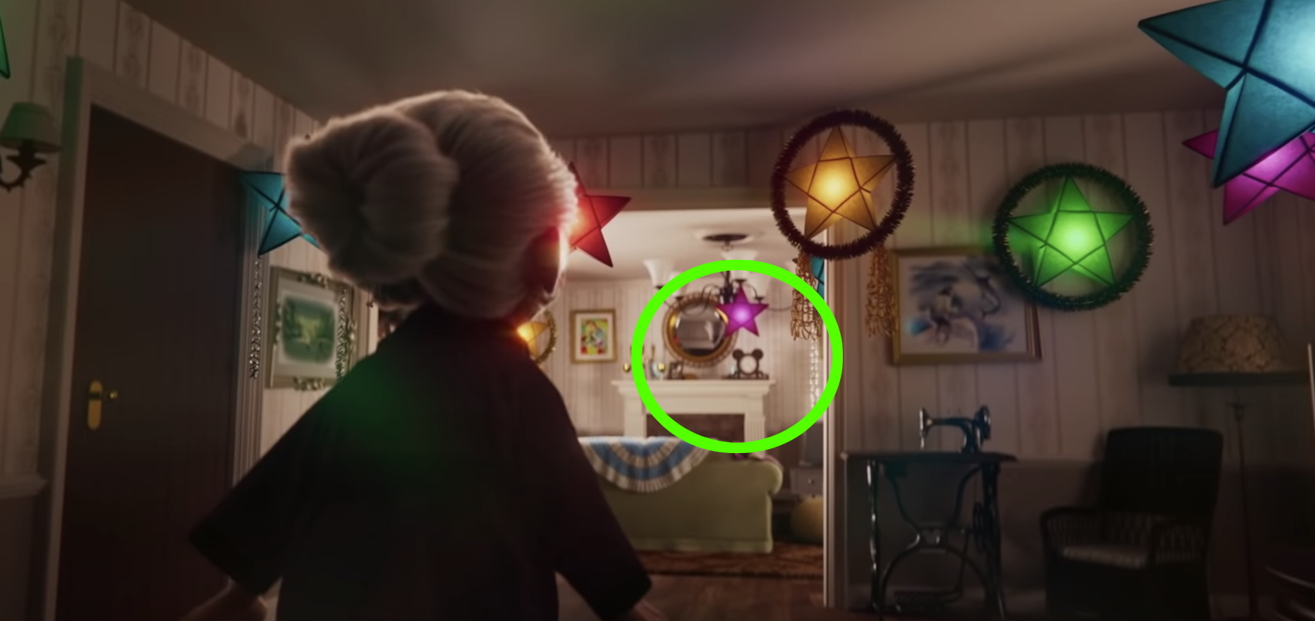 The hidden Mickey is a clock on the grandma's mantle