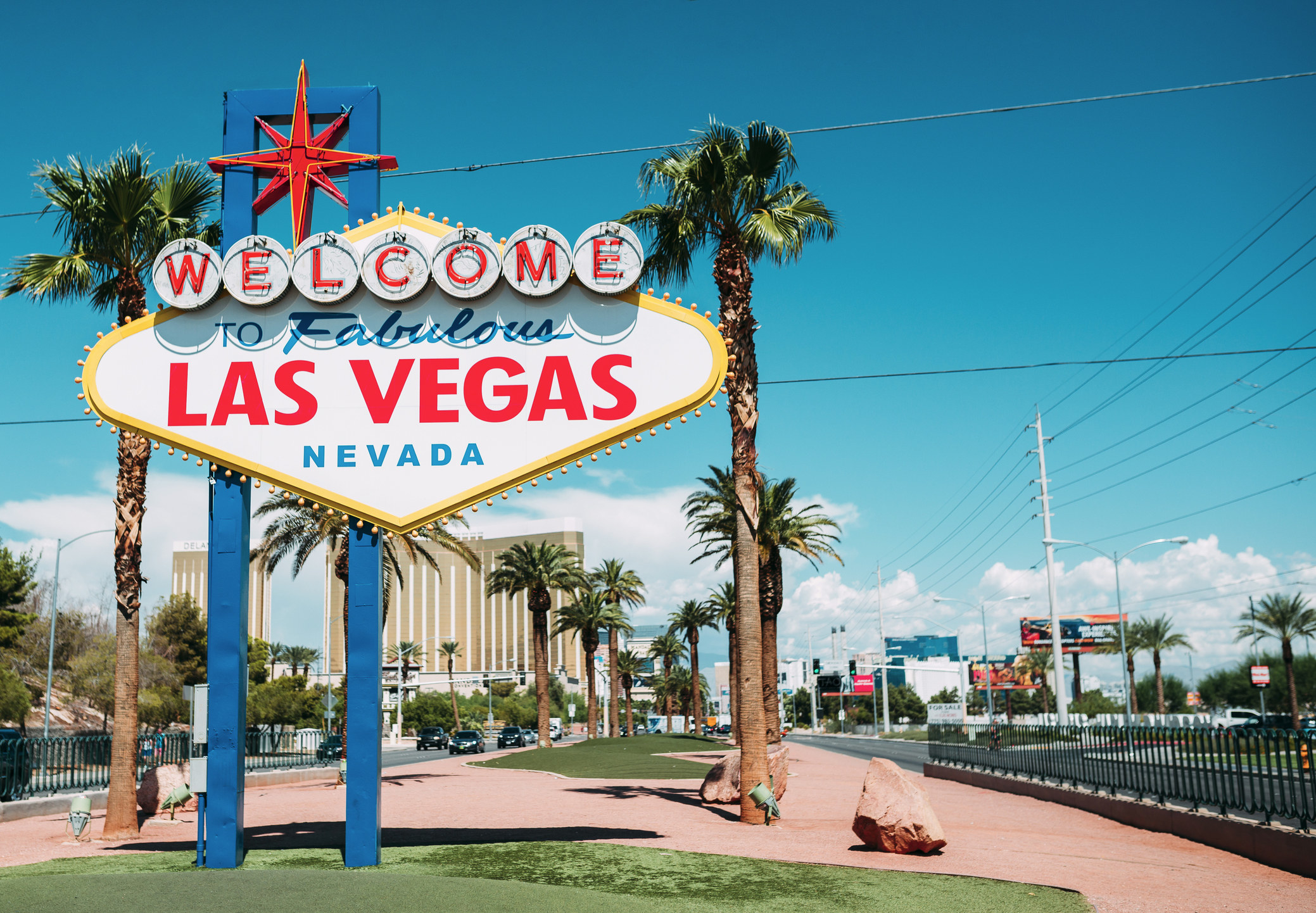 """The iconic """"welcome to fabulous las vegas"""" sign under a blue sky with a slightly grainy, old-timey filter"""