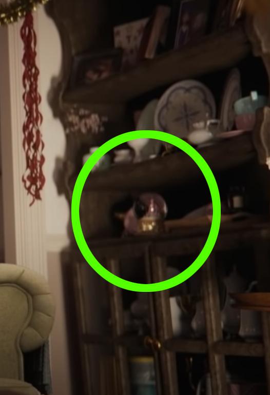 The snow globe sitting on grandma's cabinet shelf