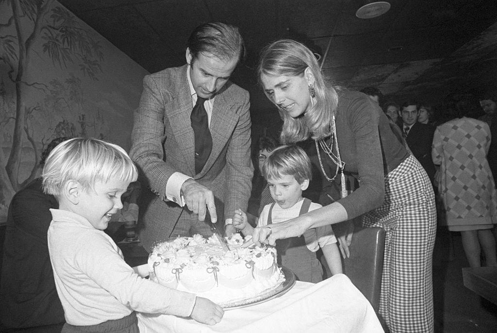 Black-and-white photo of Joe Biden with Neilia Biden and their children