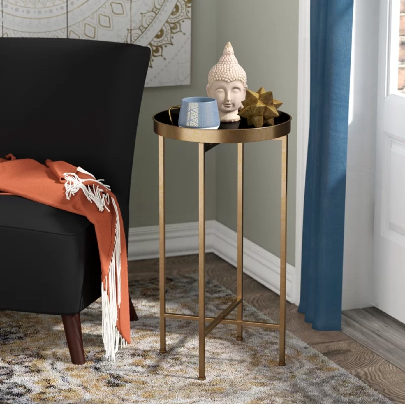 The cross leg end table in gold and black