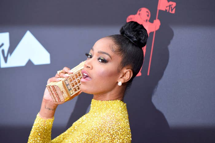 Keke holding a phone-shaped clutch to her ear as she poses at the 2020 MTV VMAs