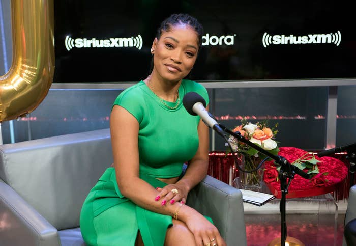 Keke posing for a picture at a radio interview