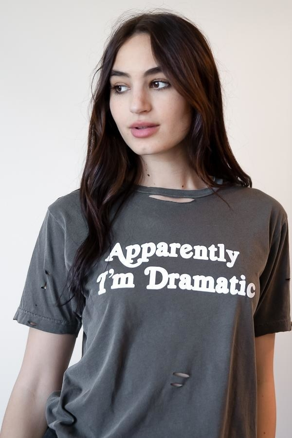 """a model in a grey t-shirt with the words """"apparently I'm dramatic"""" on it"""