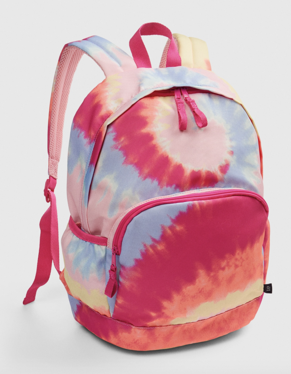 Product shot of tie-dye backpack with swirls of various colors