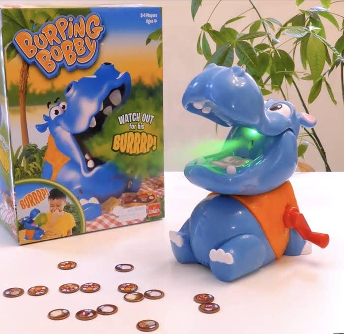 A plastic hippo emits a green mist