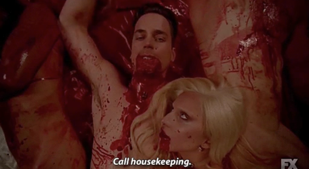 """A scene from """"AHS: Hotel"""" where Lady Gaga and Cheyenne Jackson lie naked, covered in blood"""