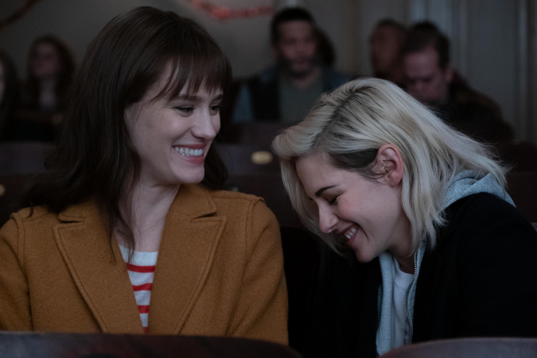 Kristen Stewart and Mackenzie Davis sharing a laugh