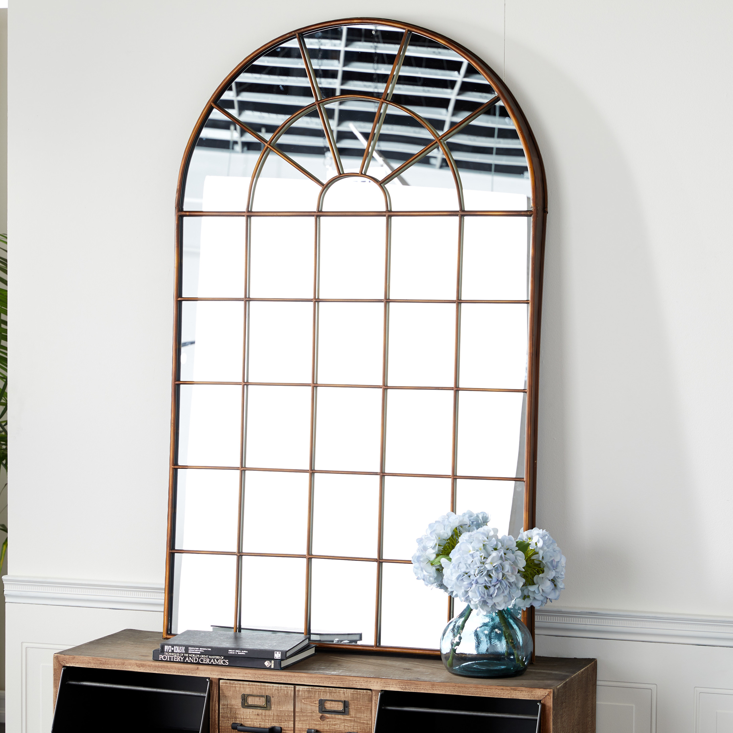 Curved top mirror with metal planes