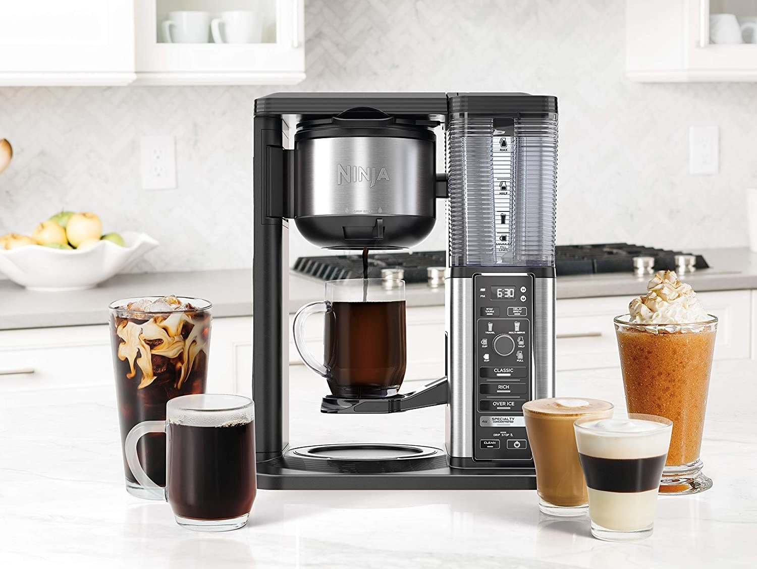A ninja coffee maker surrounded by various types of coffee drinks