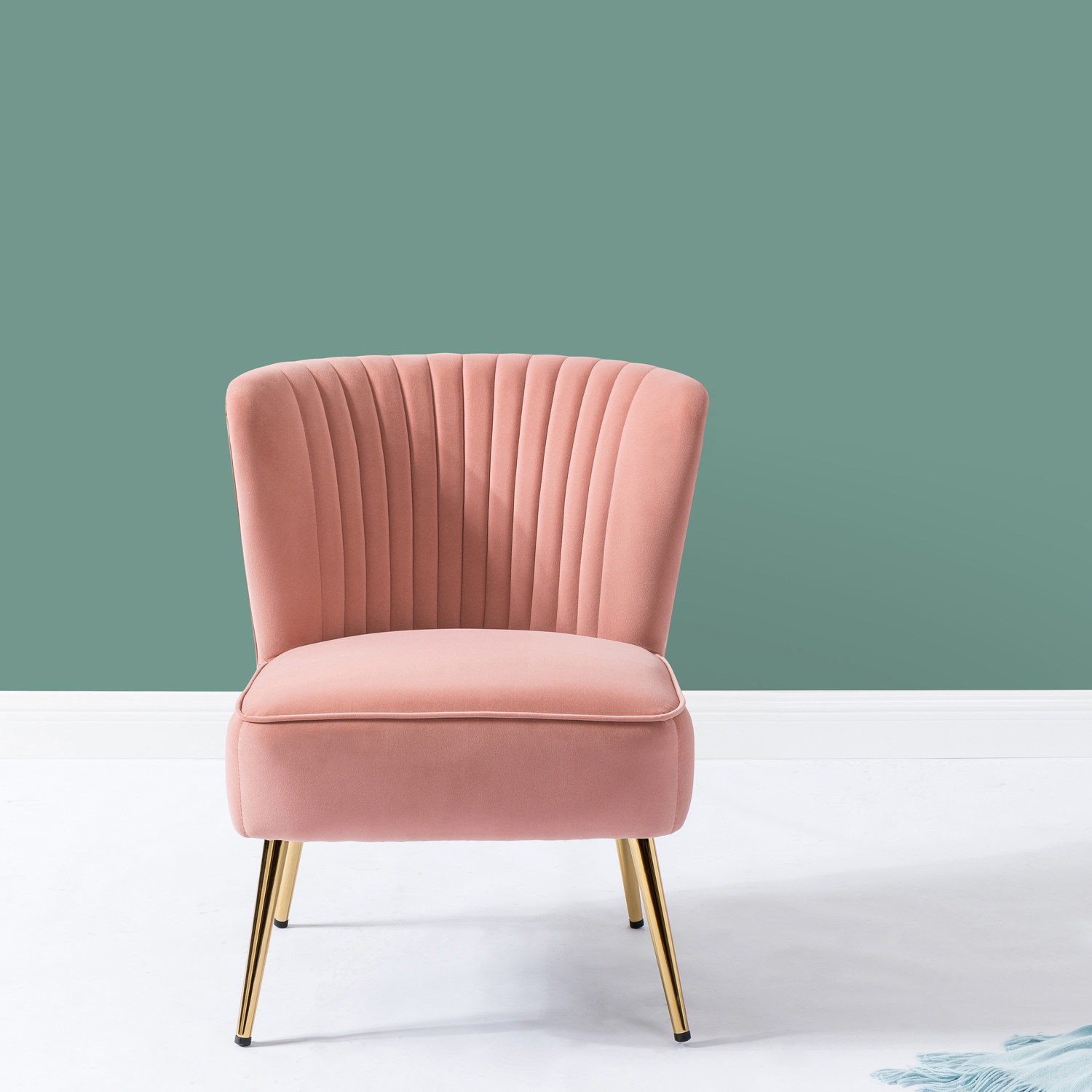 Pink velvet chair with gold posts