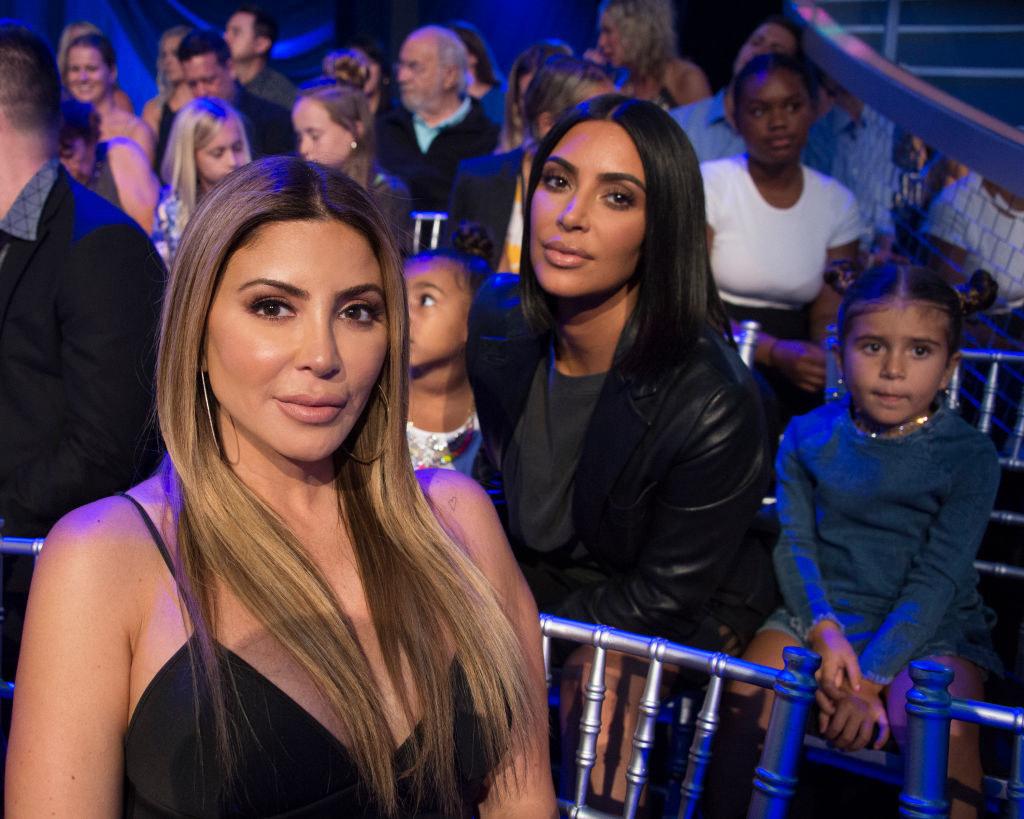 Larsa Pippen and Kim Kardashian posing at an event
