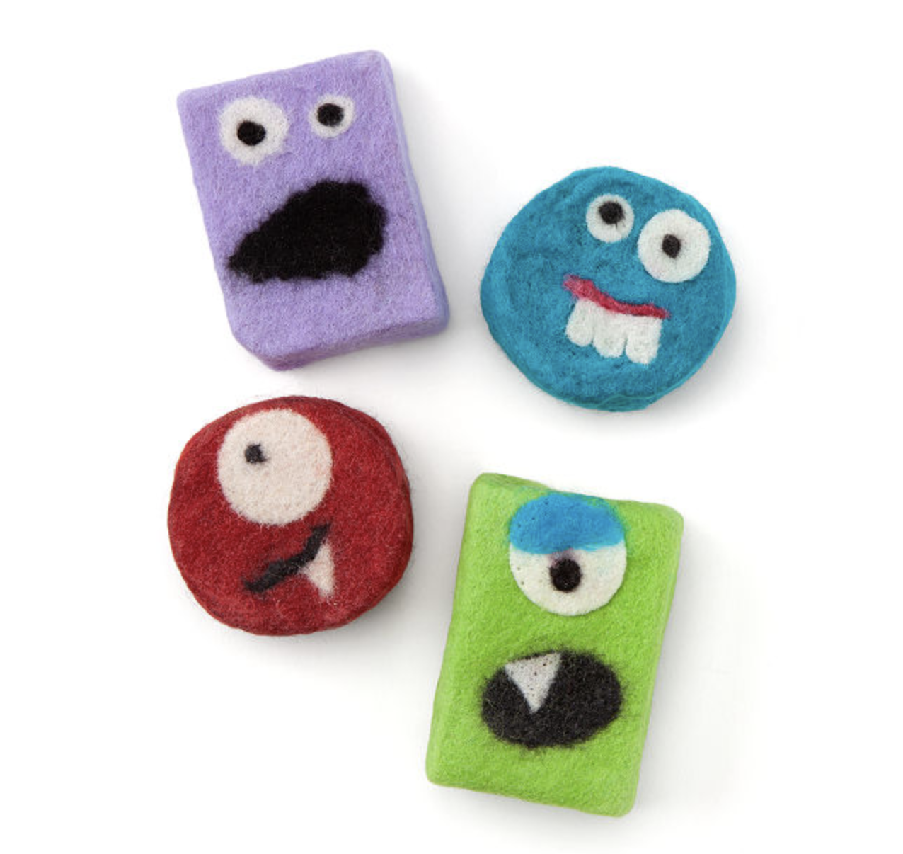 Four soaps with monster faces