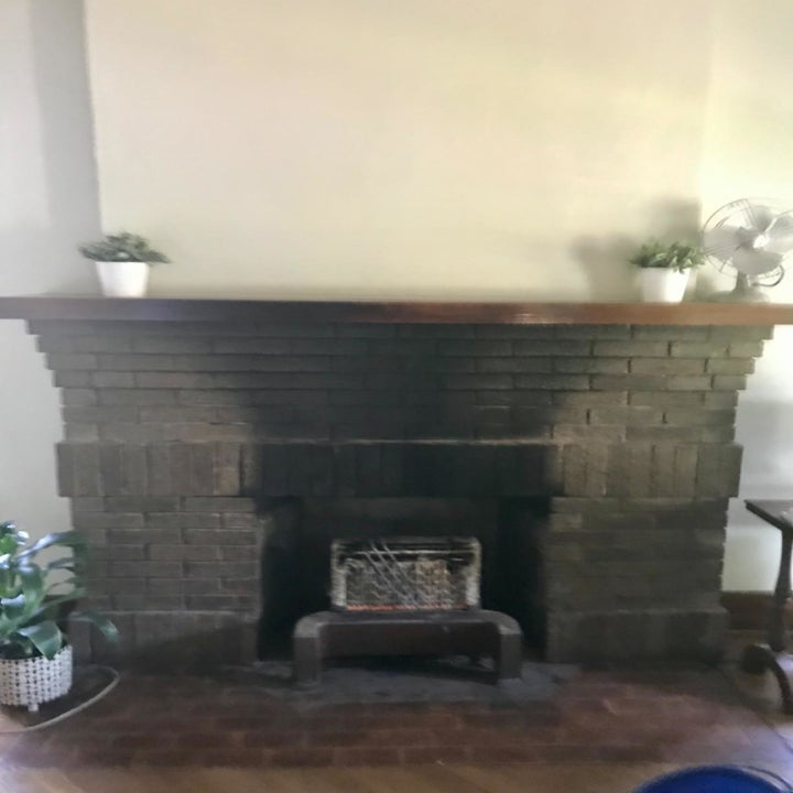 Reviewer's soot-covered fireplace mantel
