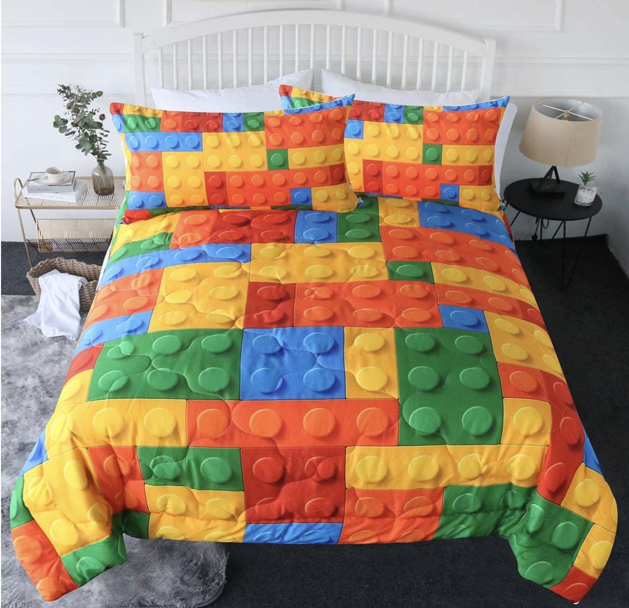 A comforter with a Lego bricks design
