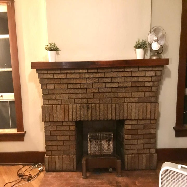 Reviewer's clean fireplace mantel (no soot stains) after using the fireplace cleaner