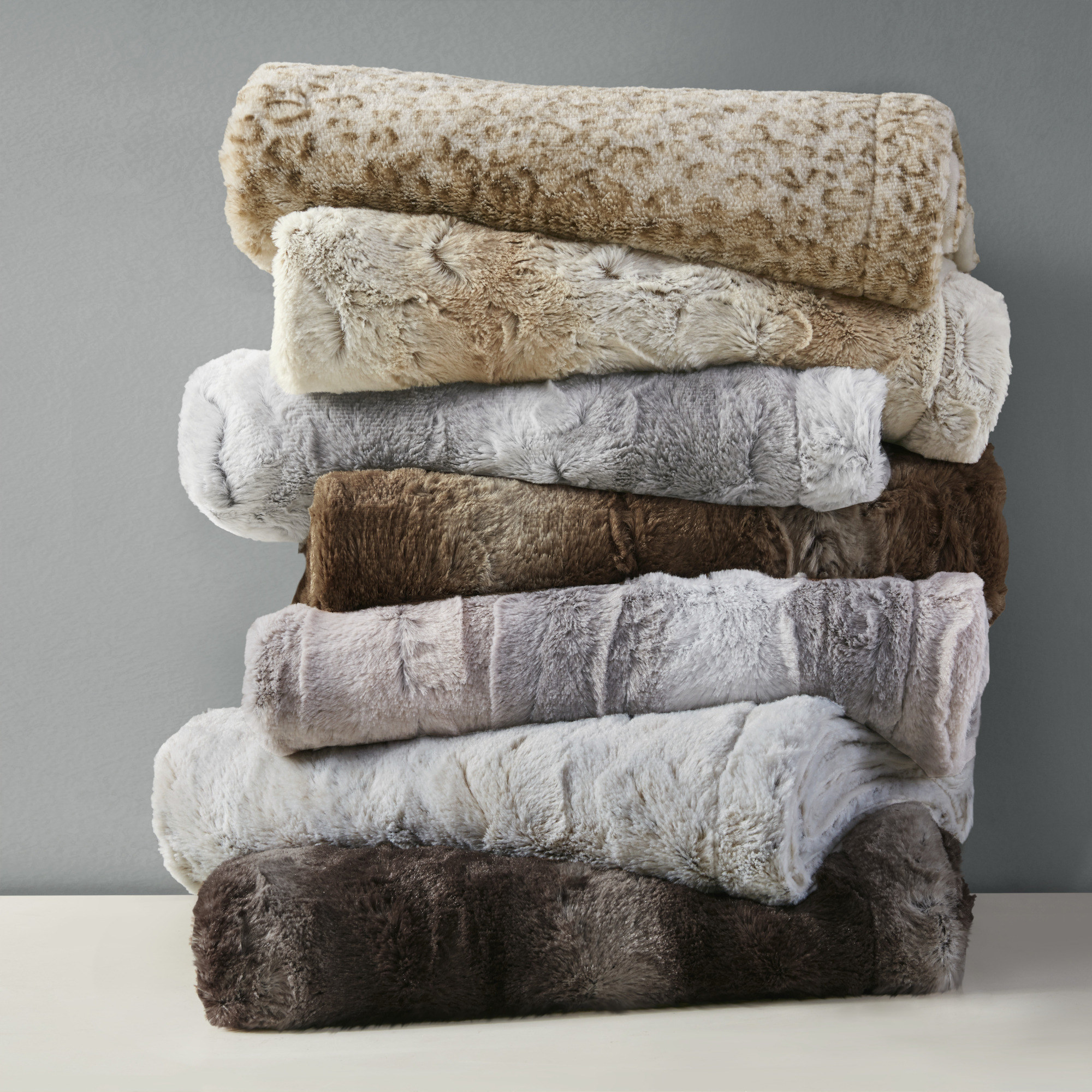 Stack of faux-fur throws