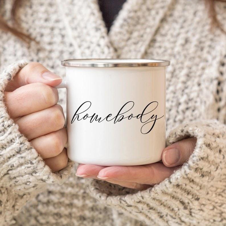 A mug that says homebody