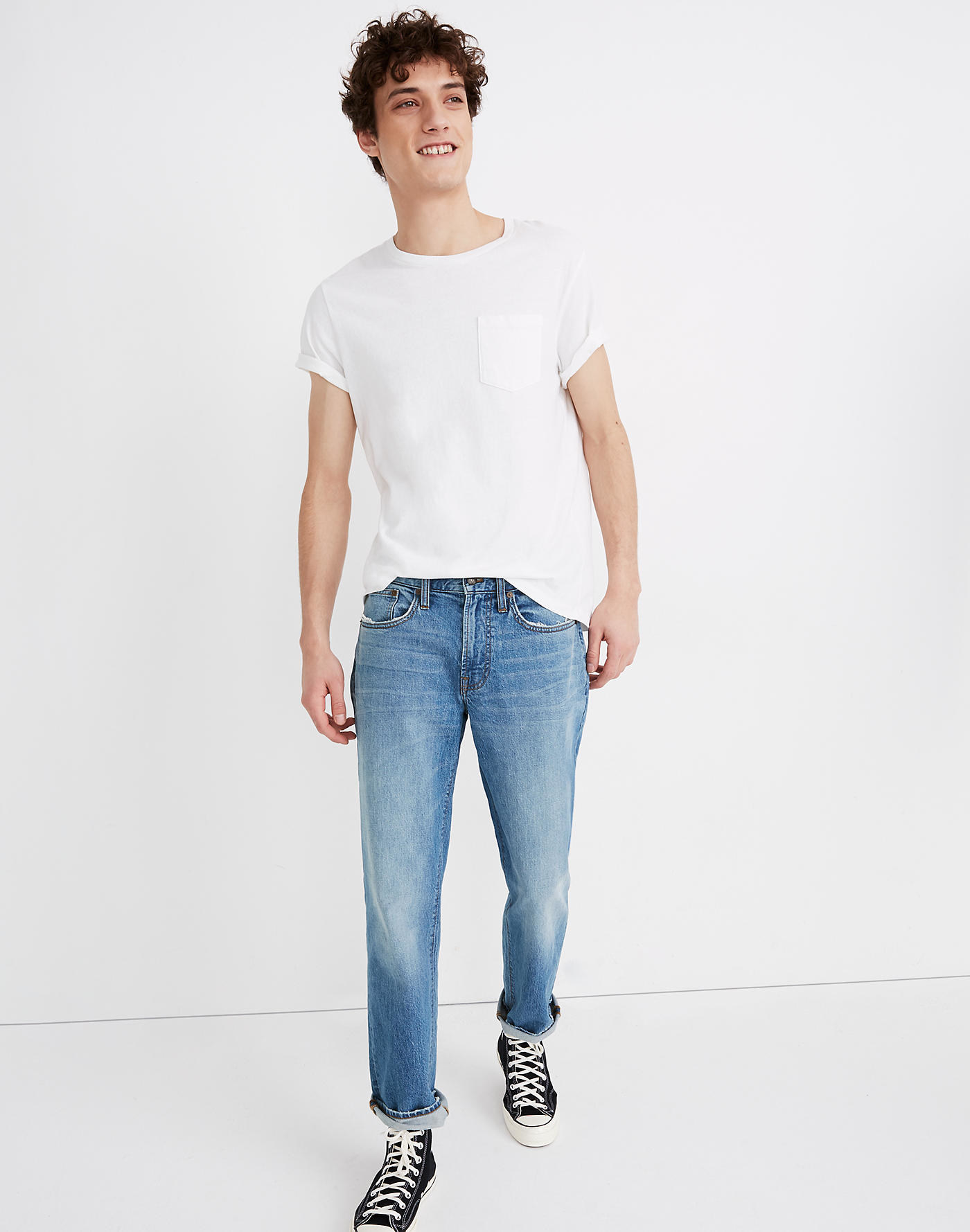 model wearing relaxed straight jeans in eastchase wash