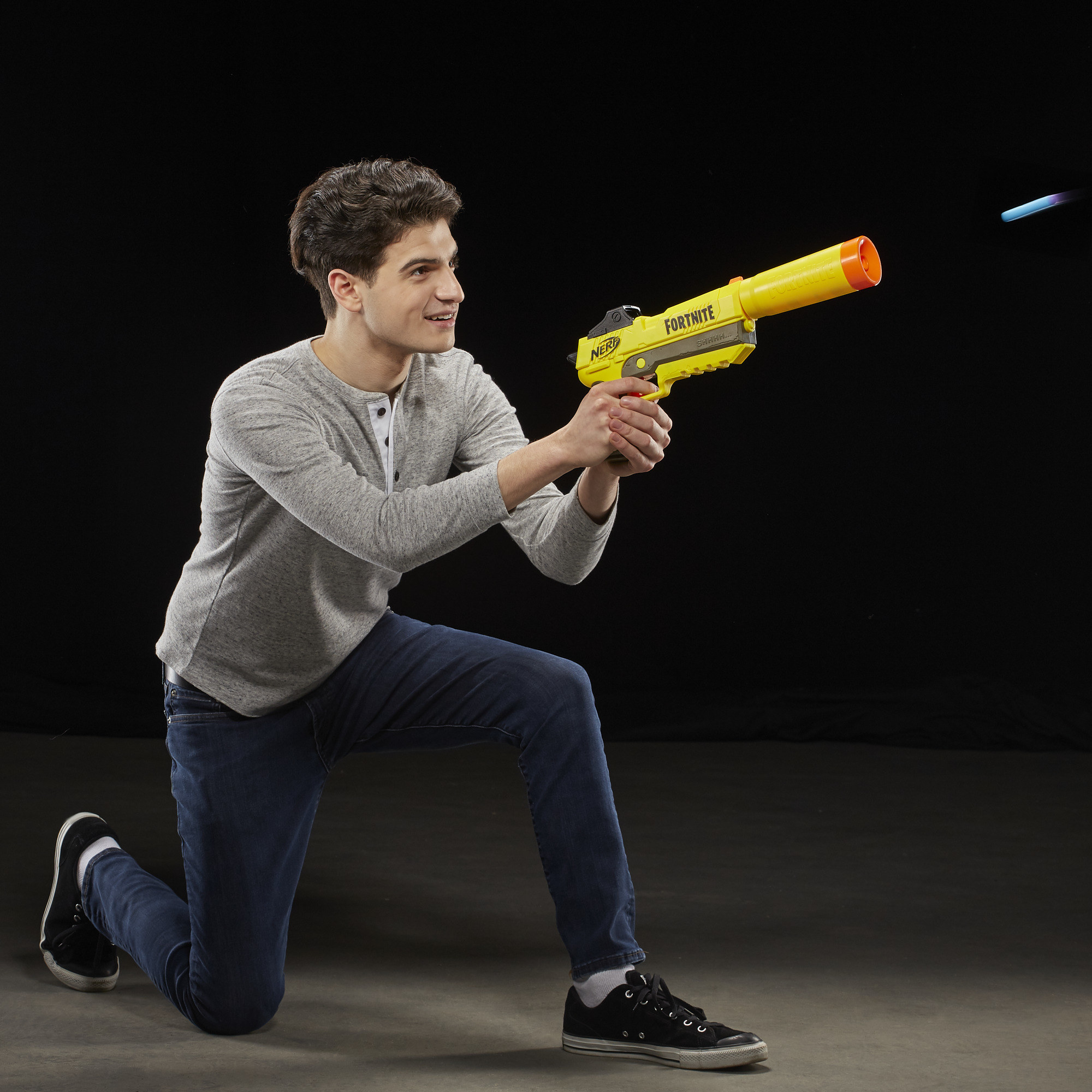 The Nerf blaster, which shoots small foam rubber darts from its barrel