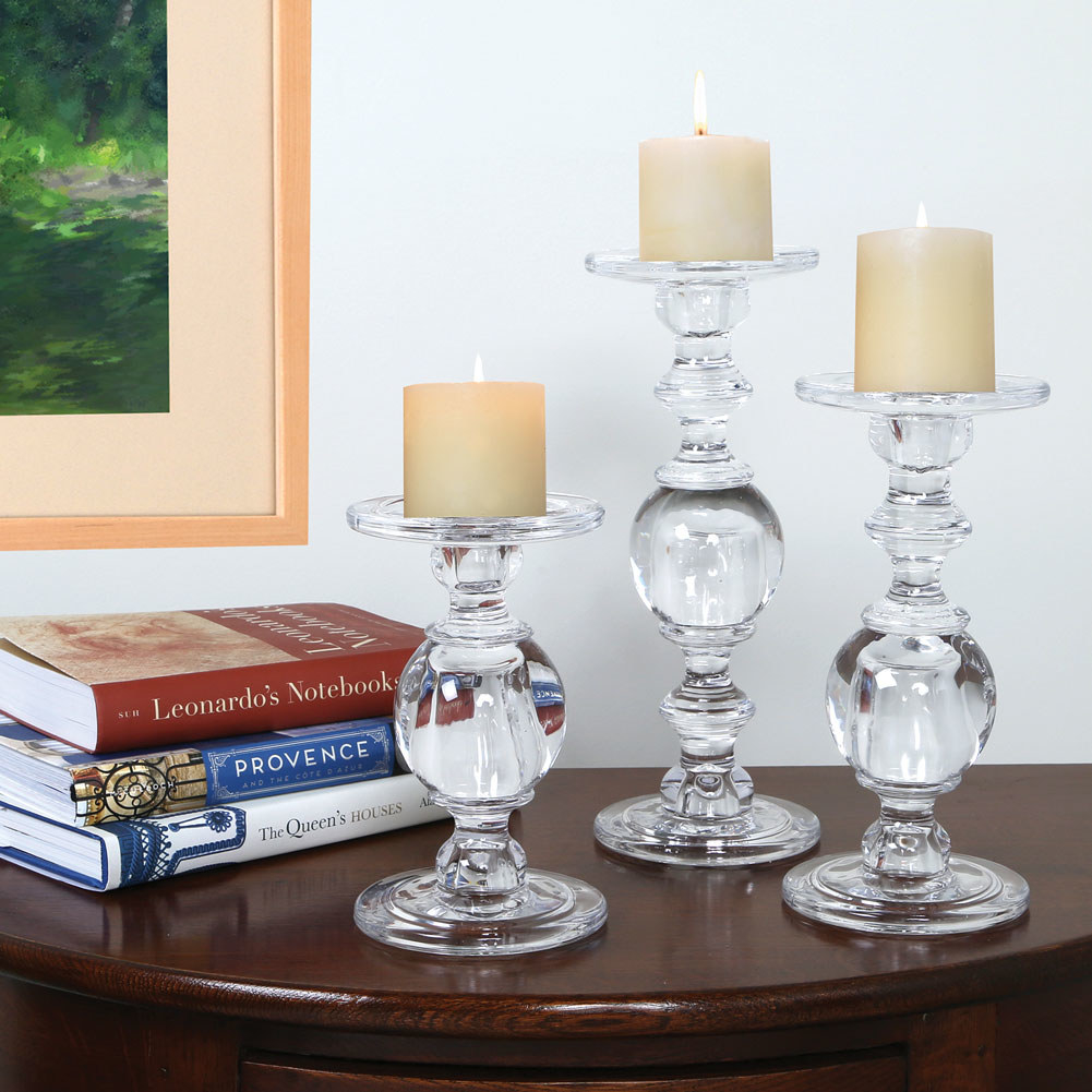 Set of three tiered glass candle holders