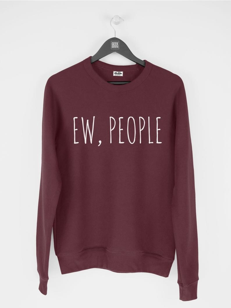 A sweater that says ew people