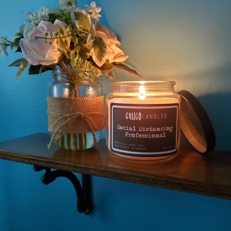 A candle that says social distancing professional