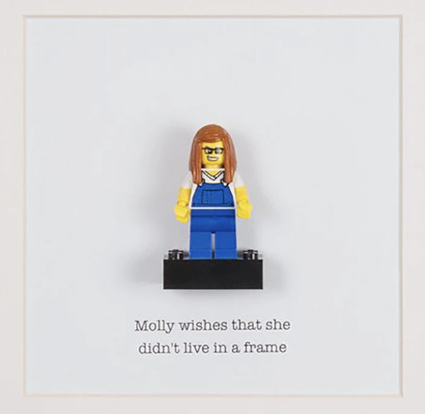A Lego figurine that looks like a woman with glasses and long hair