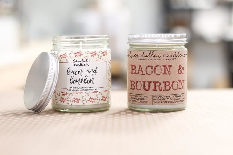Two candles: one with a white label with handwritten font, one with kraft paper label with all-caps stamped font