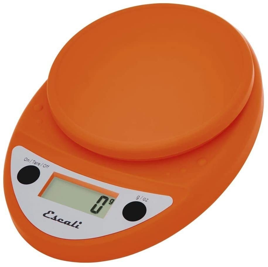 Orange smart food scale isolated on a white background