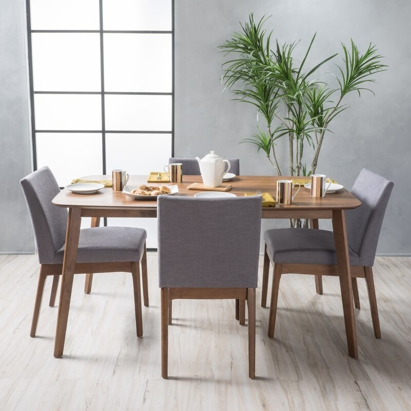 gray chairs with walnut table